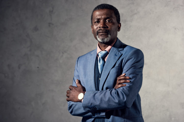 confident mature african american man with crossed arms